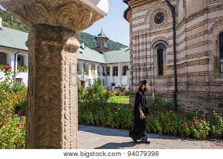 Priest Walking Inside Cozia Monastery