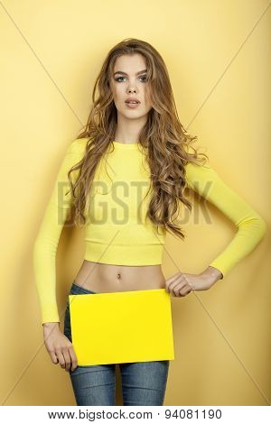 Thin Woman Holding Yellow Sheet Of Paper