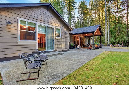 Large Back Yard With Grass.