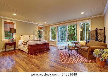 Large Master Bedroom Wth Hardwood Floor.