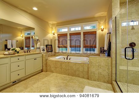 Large Master Bathroom With Tile Floor And Tub.