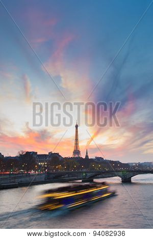 Sunset over Eiffel Tower and Seine river.