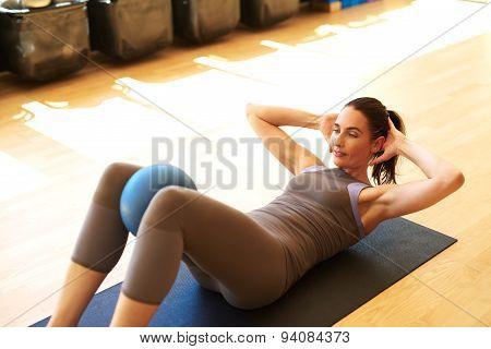 Beautiful Female Is Doing Pilates