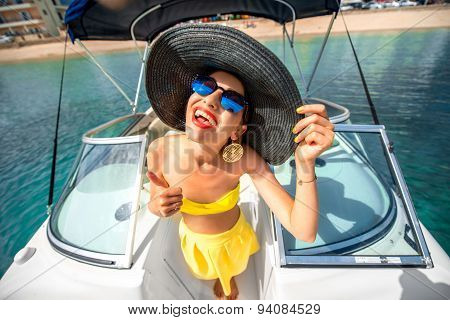 Woman having fun on the yacht