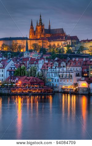Beautiful And Historic Charles Bridge With Castle In Background At Dusk In Prague, Czech Republic