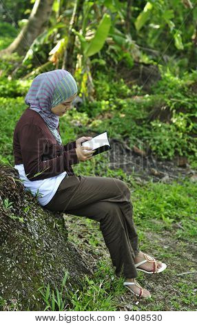 beautiful young girl reading book