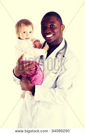 Smiling doctor with small baby girl