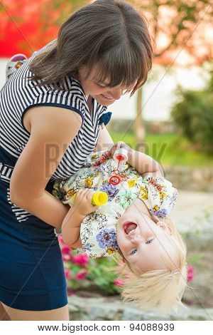 Happy Mother And Daughter Enjoying On Nature