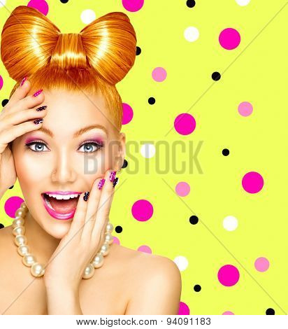 Beauty fashion happy model girl with funny bow hairstyle, pink nail art and makeup over polka dots green background. Red hair. Laughing retro styled young woman