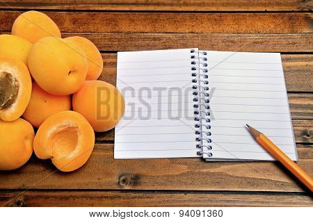 Apricots Fruit With Empty Notebook