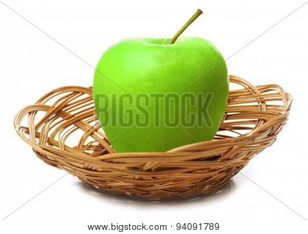 Apple in wicker basket isolated on white