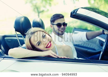 Young couple in cabriolet, outdoors