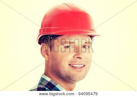Portrait of an handsome engineer in helmet