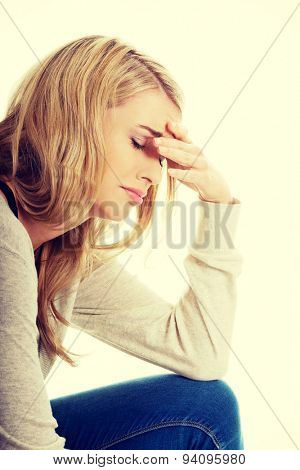 Sad and depressed woman deep in thought.