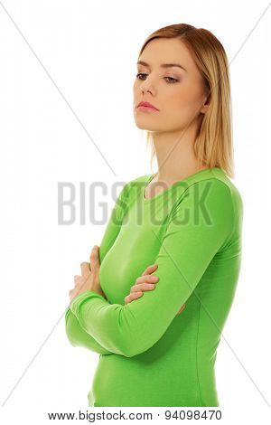 Annoyed young woman with arms crossed.