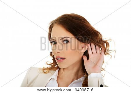 Beautiful businesswoman overhears a conversation.