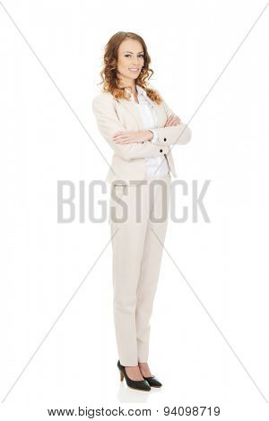 Confident businesswoman with crossed arms.