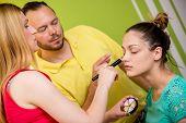 picture of makeup artist  - Makeup teacher helping students training to become makeup artist  - JPG