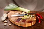 stock photo of leek  - leek Chile garlic and knife on a chopping board - JPG