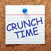 image of crunch  - The phrase Crunch Time in blue ext on an index card pinned to a cork notice board as a reminder to make a decision - JPG