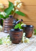 image of teapot  - Teapot with small cups and jasmine flowers - JPG