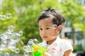picture of blowers  - Lovely Girl play with bubble blower at outdoor - JPG