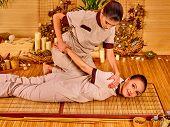 foto of thai massage  - Therapist giving Thai stretching massage to woman - JPG
