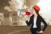 image of announcement  - Woman in hardhat with megaphone making announcement - JPG