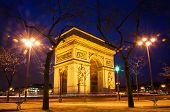 stock photo of bonaparte  - Arc de Triomphe in Paris at night - JPG
