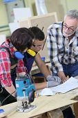 image of carpentry  - Young people in carpentry course with teacher - JPG