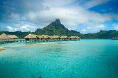 Постер, плакат: Luxury Thatched Roof Bungalow Resort On Bora Bora