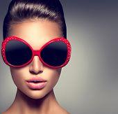 foto of beautiful lady  - Beauty Fashion model brunette girl wearing stylish sunglasses - JPG