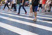 stock photo of pedestrians  - Pedestrians crowd in city street abstract blur - JPG