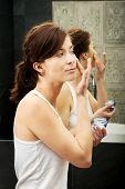 foto of anti  - Attractive woman putting anti - JPG