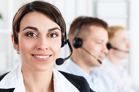image of employee  - Three call center service operators at work - JPG