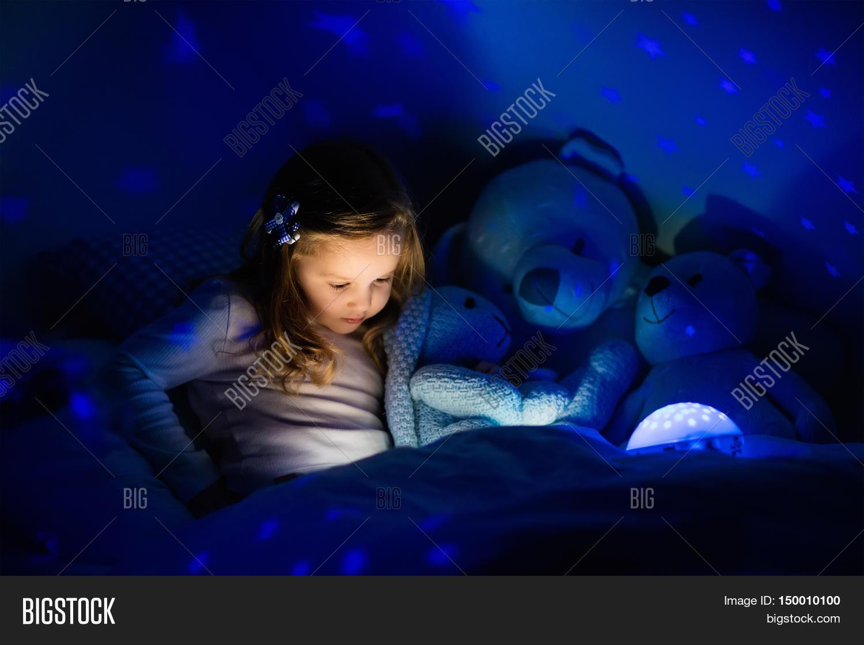Dark Bedroom At Night Little Girl Reading Book Beddark Image & Photo  Bigstock
