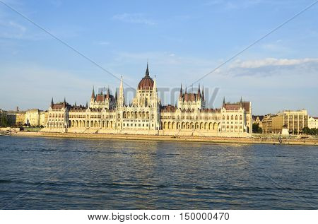 Famous building of Hungarian Parliament along the Danube River in Budapest. The Parliament, built in Neo-Gothic style and located on the bank of Danube.