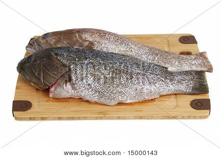 Two Scaled  Grouper Fish On Bamboo Cutting Board