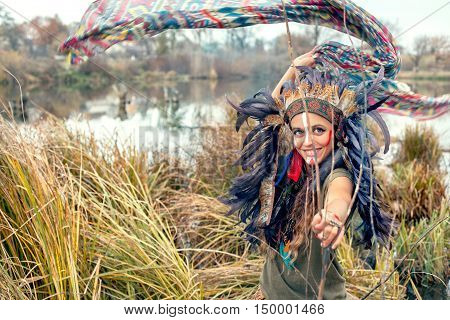 Native American Girl In National Clothes In The Field