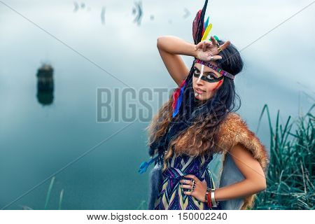 Native American Girl In National Clothes Posing