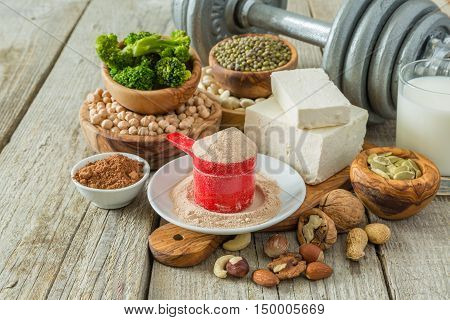 Selection vegan protein sources on wood background, copy space
