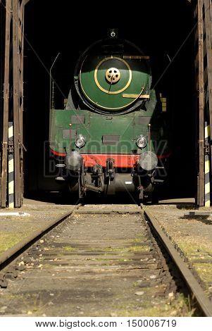 Old Vintage Steam Locomotives At The Train Depot