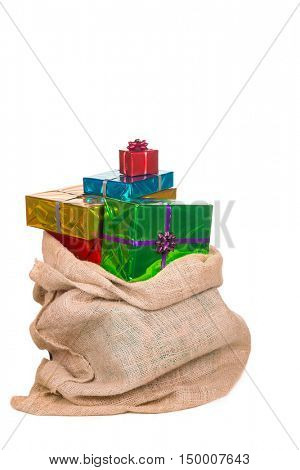 Sack of Sinterklaas with gifts .Isolated on white background. Typical Dutch character part of a traditional event celebrating the birthday of st.Nicolaas (Santa Claus) in december.