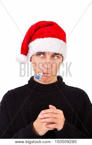 Young Man in Santa Hat and Thermometer Isolated on the White Background
