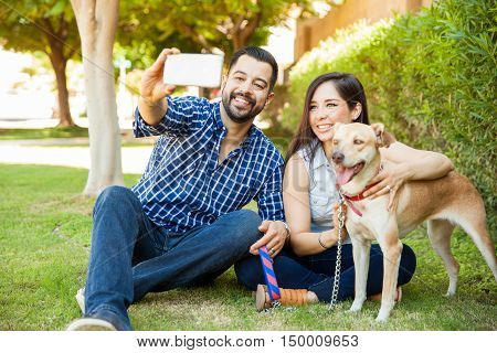 Happy Family With A Dog Taking Selfie
