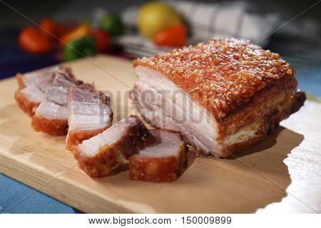 Oriental Roast Pork Belly on wooden chopping board