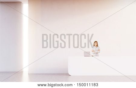 Cheerful receptionist is standing near her white counter with laptop and looking at the viewer. Concept of large company work. 3d rendering. Mock up. Toned image