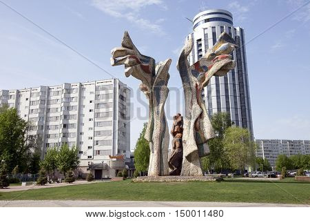 Spring cityscape Enthusiasts boulevard with fountains sculptures and manicured blooming flower beds