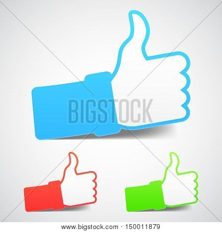 Set of three thumb up icons with soft shadows and different colors