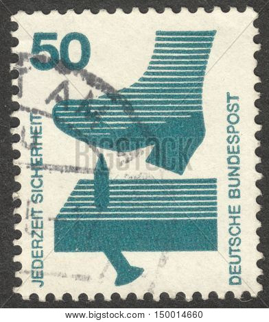 MOSCOW RUSSIA - CIRCA SEPTEMBER 2016: a stamp printed in GERMANY shows a protruding nail in the plank the series